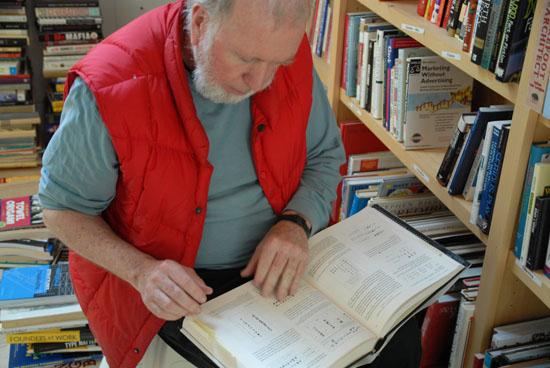 Kevin Kelly selecting books for the Manual For Civilization (photo by Catherine Borgeson)